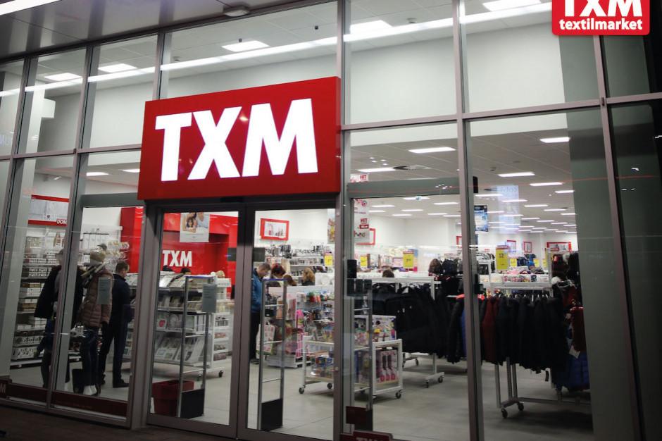 TXM zmniejsza stratę o 9,5 mln zł
